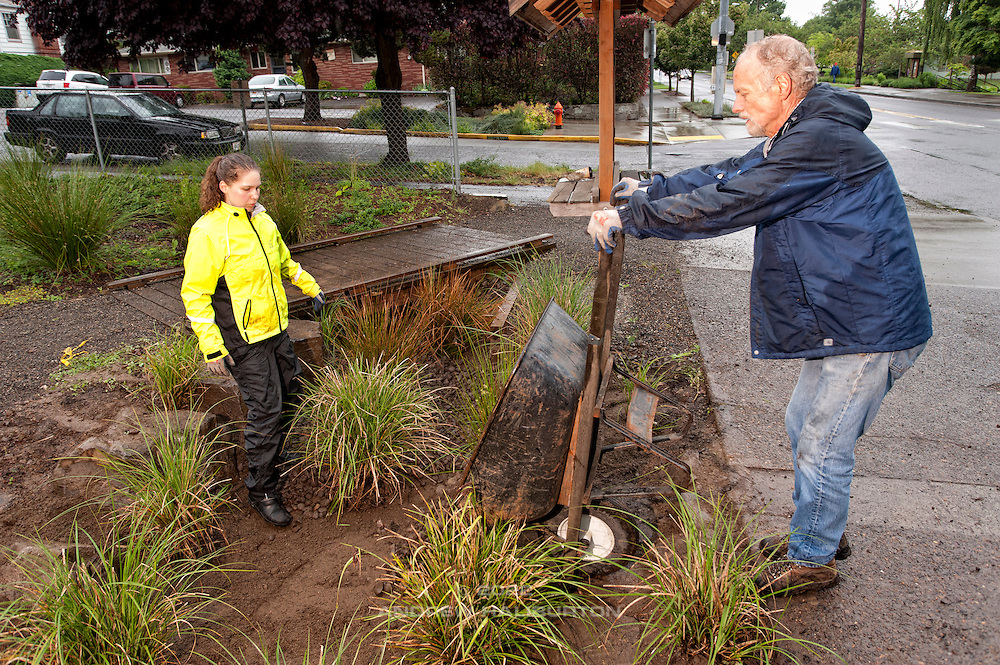 Laura Vail and Gary Riggs volunteer at the rain garden work meet, Café au Play at Tabor Commons, a project of the Southeast Uplift Neighborhood Coalition (SEUL) and volunteers from Portland's Mt Tabor neighborhood.