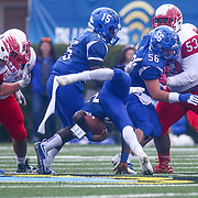 Middletown running back NAJAIR SMITH (20) is tripped up after gaining a few yards during the 2017 DIAA Division I state championship game between the Smyrna Eagles and Middletown Cavaliers Saturday, Dec. 02, 2017 at Delaware Stadium in Newark, DE.