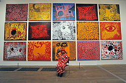 © Licensed to London News Pictures. 07/02/2012, London, UK. YAYOI KUSAMA pictured with her work. Press preview of Yayoi Kusama at the Tate Gallery Bankside today 7th February 2012. The exhibition spans six decades of the artists work. Kusama is one of Japan's best known living artists.  Photo credit : Stephen Simpson/LNP