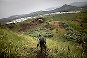 A FARDC soldier patrols the hills around the Mugunga IDP site, outside Goma, DRC.