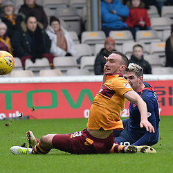Tom Aldred (Motherwell) blocks a shot from Kyle Lafferty (Hearts) during the Scottish Cup quarter final between Motherwell and Hearts at Fir Park, where the home side made it into the semi final draw with a win.<br /> <br /> <br /> (c) Dave Johnston | sportPix.org.uk
