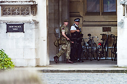 May 24, 2017 - London, London, UK - An armed British army soldier and an armed policeman patrol the Houses of Parliament in response to an imminent terrorist attack following the Manchester Arena bombing on May 24, 2017 (Credit Image: © Ray Tang via ZUMA Wire)