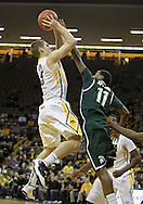February 2 2011: Iowa Hawkeyes guard Matt Gatens (5) puts up a shot over Michigan State Spartans guard Keith Appling (11) during the first half of an NCAA college basketball game at Carver-Hawkeye Arena in Iowa City, Iowa on February 2, 2011. Iowa defeated Michigan State 72-52.