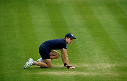 LONDON, ENGLAND - Monday, July 2, 2012: A ball boy during the Boys' Singles 1st Round match on day seven of the Wimbledon Lawn Tennis Championships at the All England Lawn Tennis and Croquet Club. (Pic by David Rawcliffe/Propaganda)