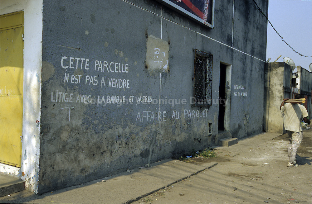 -THIS PARCEL IS NOT TO SELL : LITIGATION WITH THE BANK AND OTHERS3 WRITEN ON A SHOP WALL OF POTO POTO DISTRICT, BRAZZAVILLE, CONGO