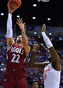SAN DIEGO, CA - MARCH 16:  Eli Chuha #22 of the New Mexico State Aggies gets a layup against Elijah Thomas #14 of the Clemson Tigers during a first round game of the Men's NCAA Basketball Tournament at Viejas Arena in San Diego, California. Clemson won 79-68.  (Photo by Sam Wasson)