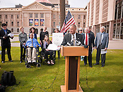 06 FEBRUARY 2012 - PHOENIX, AZ:    Arizona State Senator STEVE GALLARDO, a Democrat, explains his opposition to a state bill that would allow concealed weapons on college campuses on Monday, Feb. 6. The Arizona State Senate's Judiciary Committee, chaired by Sen Ron Gould (Republican) debated several bills Monday that would loosen the state's gun laws, already among the loosest in the United States. One bill would allow anyone with a concealed carry permit to carry guns on the grounds of public universities. Universities could only ban guns if they provided secured gun lock boxes in each building. Universities, which are opposed to the legislation, say that the lock boxes would cost hundreds of thousands of dollars and that guns would make the campuses less safe. Most of the police departments in Arizona, as well as university student bodies, also oppose the legislation to allow guns on campus.  PHOTO BY JACK KURTZ