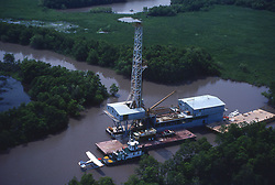 Stock photo of an offshore barge rig with float plane in south Louisiana waterway