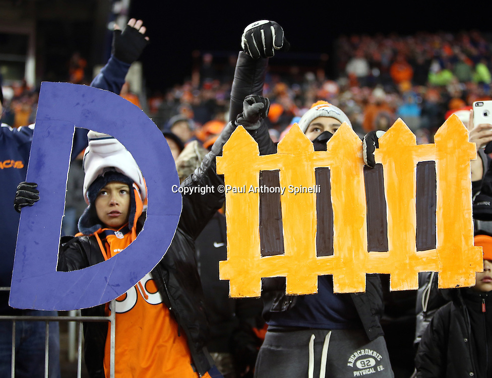 Denver Broncos fans hold up a defense sign in overtime hoping that the Broncos field goal advantage will hold up and get them a win during the Denver Broncos 2015 NFL week 16 regular season football game against the Cincinnati Bengals on Monday, Dec. 28, 2015 in Denver. The Broncos won the game in overtime 20-17. (©Paul Anthony Spinelli)