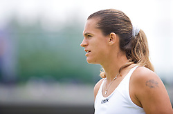LONDON, ENGLAND - Friday, June 26, 2009: Amelie Mauresmo (FRA) during the Ladies' Doubles 2nd Round match on day five of the Wimbledon Lawn Tennis Championships at the All England Lawn Tennis and Croquet Club. (Pic by David Rawcliffe/Propaganda)