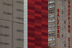 © Licensed to London News Pictures . 11/10/2018. Salford , UK . GV of Courts on The Square with temporary cladding fitted on some levels , unsafe cladding fitted on others and Salford Shopping City in the background . Recently installed cladding at several council-owned tower blocks in Salford has been identified as having similar dangerous properties to that which was installed on the Grenfell Tower in London . Residents have been waiting months for clarification on what action will be taken to make their homes safe . Photo credit : Joel Goodman/LNP