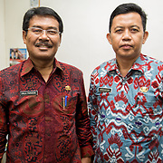 CAPTION: Mr Pola and Mr Dirmansyah are both members of the City Core Team, which was established under ACCCRN as a platform to engage key stakeholders in creating and implementing an integrated city resilience strategy. The two men are from government agencies; through the City Core Team, they work in partnership with local NGOs, the University of Lampung and members of the private sector. This enables them to access more knowledge and funding, and to facilitate the participation of more poor and vulnerable communities. LOCATION: City Government Offices, Bandar Lampung, Indonesia. INDIVIDUAL(S) PHOTOGRAPHED: Pola Pardede (left) and Mr Dirmansyah (right).