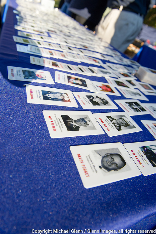 1 Oct 2017 Elmont, New York United States of America // A table is filled with cards of fallen members being honored during the 3RD annual national stair climb for fallen firefighters at the Belmont Park racetrack  Michael Glenn  /   for the FDNY