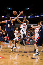 Virginia guard Sean Singletary (44) passes around Richmond guard David Gonzalvez (5).  The Virginia Cavaliers men's basketball team defeated the Richmond Spiders 66-64 in the first round of the College Basketball Invitational (CBI) tournament held at the University of Virginia's John Paul Jones Arena in Charlottesville, VA on March 18, 2008.