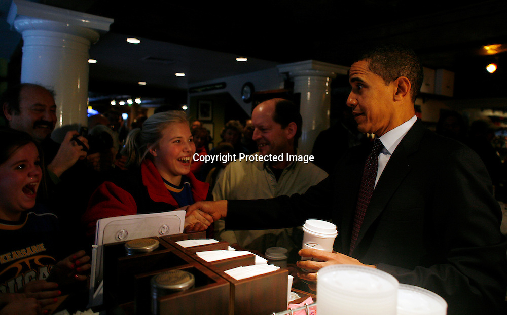 U.S. Democratic Presidential candidate Senator Barack Obama (D-IL) greets local residents during an unscheduled campaign stop in New London, New Hampshire January 6, 2008.