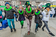 Tourists from France, Italy anfd Germay warm up with some Irish Dancing in Trafalgar Square -  the London St Patrick's Day parade from Piccadilly to Trafalgar Square.