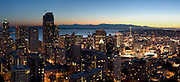 "Downtown Seattle, the Space Needle, Puget Sound and the Olympic Mountains at sunset, on July 4, 2007. Published in ""Light Travel: Photography on the Go"" book by Tom Dempsey 2009, 2010. (Panorama stitched from 4 images; photographed by Tom Dempsey from the 33rd floor of First Hill Plaza, 1301 Spring Street, Seattle, Washington.)"