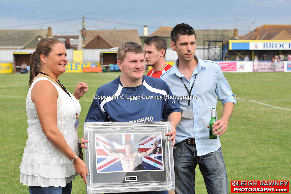 Ricky Hatton presents a signed photograph at the Indee Rose Charity Football Tournament at Canvey Island Football Club on 25th July 2010. www.theindeerosetrust.org. Photo credit: © Leigh Dawney