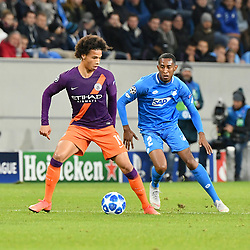 SINSHEIM, Oct. 3, 2018  Joshua Brenet (R) of Hoffenheim and Leroy Sane of Manchester City battle for the ball during the Group F match of the UEFA Champions League between  Hoffenheim of Bundesliga and Manchester City of Premier league at Wirsol Rhein-Neckar-Arena in Sinsheim, Germany, Oct. 2, 2018. Manchester City won 2-1. (Credit Image: © Ulrich Hufnagel/Xinhua via ZUMA Wire)