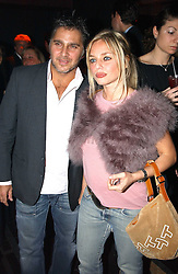 Former model SUZANNE MIZZY and FRANK CAMILLERI at a party to celebrate a new collection of sexy underware by Janet Reger called 'Naughty Janet' held at 5 Cavendish Square, London on 19th October 2004.<br />