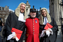 © Licensed to London News Pictures. 11/03/2019. London, UK. A Chelsea Pensioner poses for a photograph with two newly-appointed QCs outside the Palace of Westminster after the Silks Ceremony, in which new QCs are formally appointed.  Photo credit: Rob Pinney/LNP