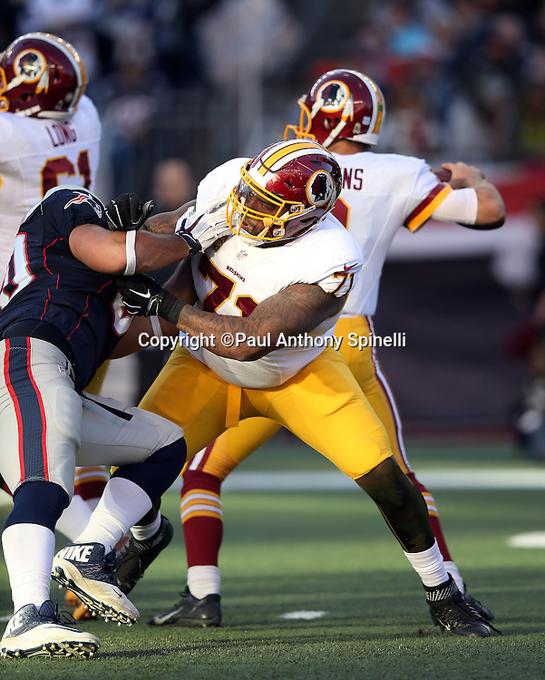 Washington Redskins tackle Trent Williams (71) pass blocks during the 2015 week 9 regular season NFL football game against the New England Patriots on Sunday, Nov. 8, 2015 in Foxborough, Mass. The Patriots won the game 27-10. (©Paul Anthony Spinelli)