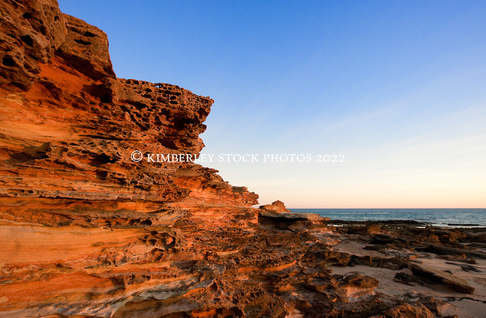 The striking sandstone formations at Broome's Riddell Beach reflect the setting sun.