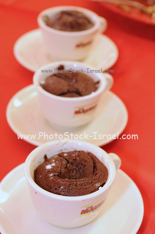 Chocolate souffle dessert baked in coffee cup
