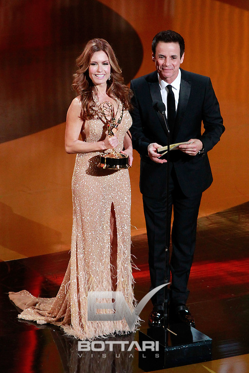 From left, Actors Tracey E. Bregman and Christian LeBlanc speak onstage during the Daytime Emmy Awards on Sunday June 19, 2011 in Las Vegas. (AP Photo/Jeff Bottari)