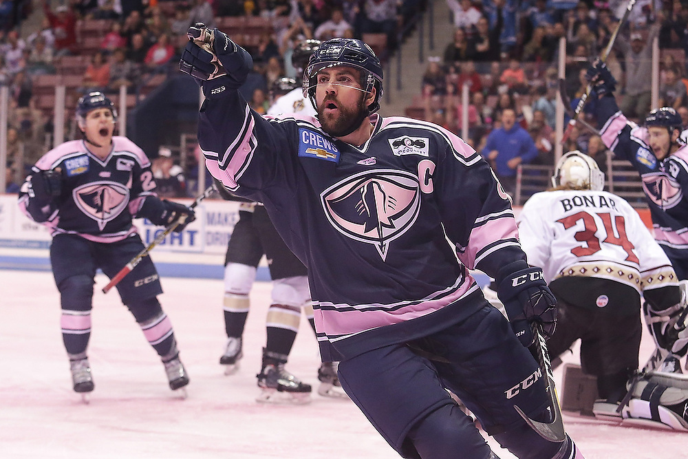 South Carolina Stingrays captain Joe Devin (8) points to the crowd after scoring the opening goal during the game against the Atlanta Gladiators. <br /> Atlanta Gladiators vs. South Carolina Stingrays at North Charleston Coliseum in Charleston, S.C. on Saturday, March 10 2017.<br /> Zach Bland/South Carolina Stingrays