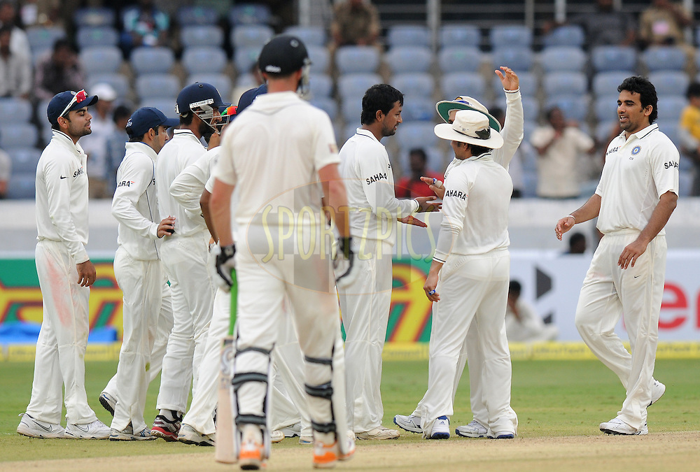 Pragyan Ojha of India celebrate the wicket of  Kane Williamson of New Zealand  during day two of the first test match between India and New Zealand held at The Rajiv Gandhi International Stadium in Hyderabad, India on the 24th August 2012..Photo by: Pal Pillai/BCCI/SPORTZPICS.