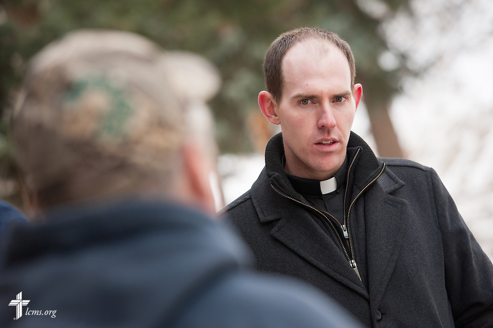 The Rev. Seth Clemmer, pastor of Mt. Calvary Lutheran Church in Estes Park, Colo., listens to Richard McGurn while touring damaged property from the September floods on Tuesday, Jan. 7, 2014, near Estes Park, Colo. LCMS Communications/Erik M. Lunsford