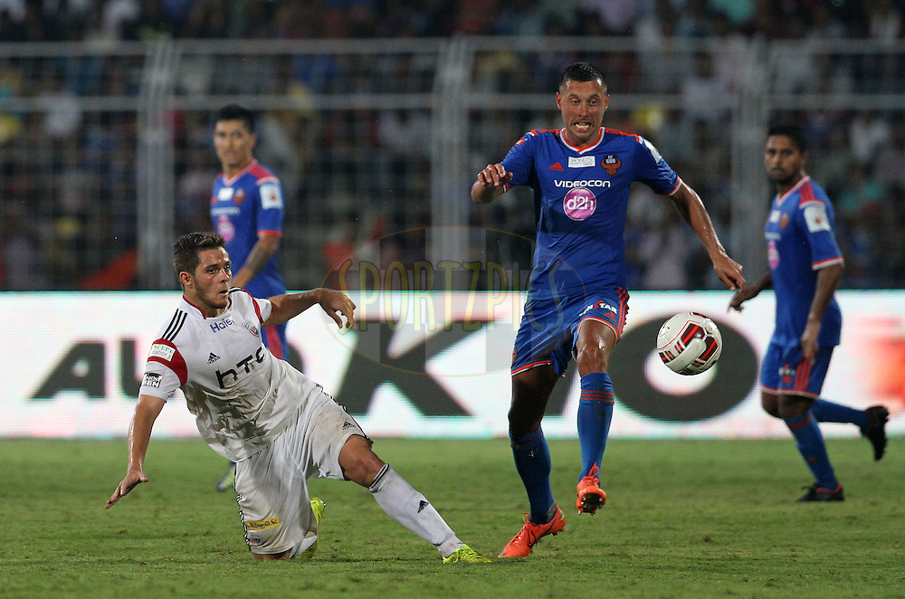 Guilherme Felipe de Castro of NorthEast United FC and Miroslav Slepicka of FC Goa in action during match 46 of the Hero Indian Super League between FC Goa and North East United FC held at the Jawaharlal Nehru Stadium, Fatorda, India on the 1st December 2014.<br /> <br /> Photo by:  Vipin Pawar/ ISL/ SPORTZPICS