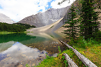 The most beautiful hike that you've never heard of! The terrain and features of the lake itself are very similar to Chester Lake (a few km down the highway), but the actual hike up to the lake is much much nicer than the hike to Chester.<br /> <br /> This is a relatively unknown trail with an unmarked trailhead and as such you won't share it with very many people (as opposed to the hundreds that visit Chester every day in the summer). Be sure to take the extra step of climbing up into Rummel Pass as it is also extremely beautiful and makes the overall trip that much better!<br /> <br /> ©2016, Sean Phillips<br /> http://www.RiverwoodPhotography.com