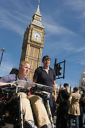 Londoners and visitors pass beneath Big Ben (now called Elizabeth Tower after the Queen's Golden Jubilee) at the Palace of Westminster, the location of Britain's parliament and goverment.