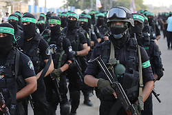 July 22, 2017 - Gaza City, Gaza Strip, Palestinian Territory - Palestinian Hamas militants take part in a military show against Israel's new security measures at the entrance to the al-Aqsa mosque compound, which include metal detectors and cameras, in Gaza city on July 21, 2017  (Credit Image: © Mohammed Asad/APA Images via ZUMA Wire)