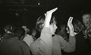 Raver dancing solely, The Boardwalk, Manchester, 1991.