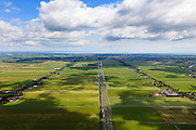 Nederland, Noord-Holland, Gemeente Purmerend, 14-06-2012; polder Wijdewormer, droogmakerij uit de 17e eeuw. Het oorspronkelijke landschap is aangetast door de aanleg van autosnelweg A7. Purmerend met daar achter IJsselmeer aan de horizon..Wijdewormer polder, reclaimed land dating from the 17th century. The original landscape has been affected by the construction of motorway A7..luchtfoto (toeslag), aerial photo (additional fee required);.copyright foto/photo Siebe Swart