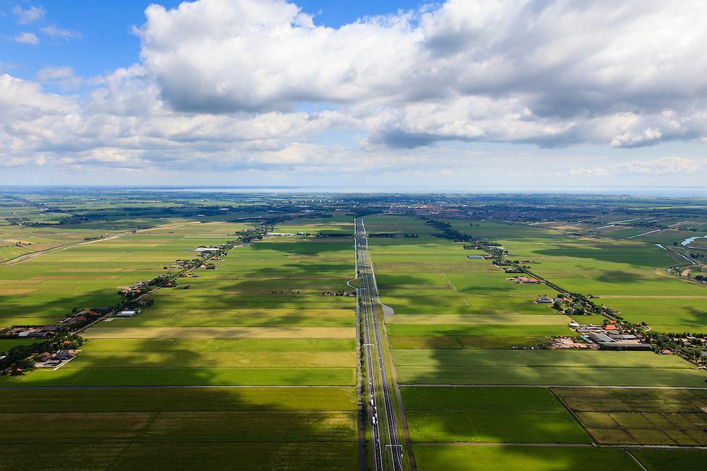 Nederland, Noord-Holland, Gemeente Purmerend, 14-06-2012; polder Wijdewormer, droogmakerij uit de 17e eeuw. Het oorspronkelijke landschap is aangetast door de aanleg van autosnelweg A7. Purmerend met daar achter IJsselmeer aan de horizon..Wijdewormer polder, reclaimed land dating from the 17th century. The original landscape has been affected by the construction of motorway A7..luchtfoto (toeslag), aerial photo (additional fee required);.copyright foto/photo Siebe Swart
