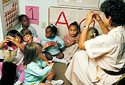 Teacher tells a story in daycare facility.