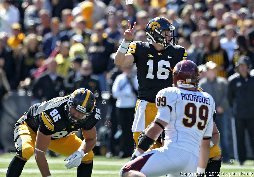 September 22 2012: Iowa Hawkeyes quarterback James Vandenberg (16) holds up two fingers as he signals at the line during the second half of the NCAA football game between the Central Michigan Chippewas and the Iowa Hawkeyes at Kinnick Stadium in Iowa City, Iowa on Saturday September 22, 2012. Central Michigan defeated Iowa 32-31.