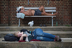 © licensed to London News Pictures. London, UK 26/08/2013. People sunbathing at Parliament Hill Lido in London as they enjoy the hot weather on bank holiday on Monday, 26 August, 2013 . Photo credit: Tolga Akmen/LNP