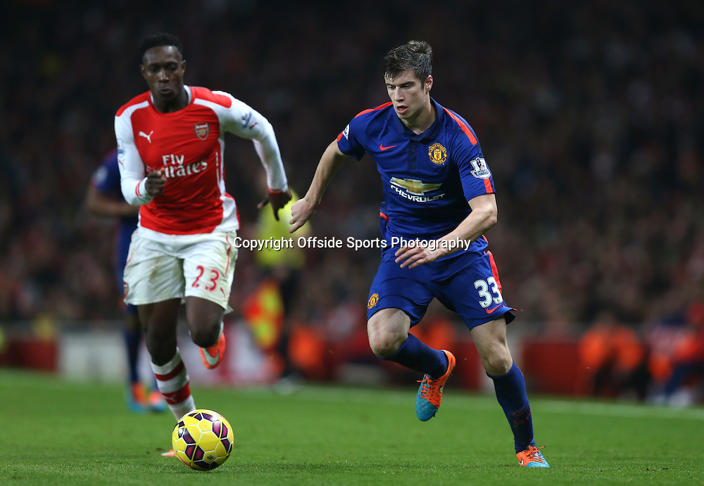 22 November 2014 - Barclays Premier League - Arsenal v Manchester United - Paddy McNair of Manchester United in action with Danny Welbeck of Arsenal - Photo: Marc Atkins / Offside.
