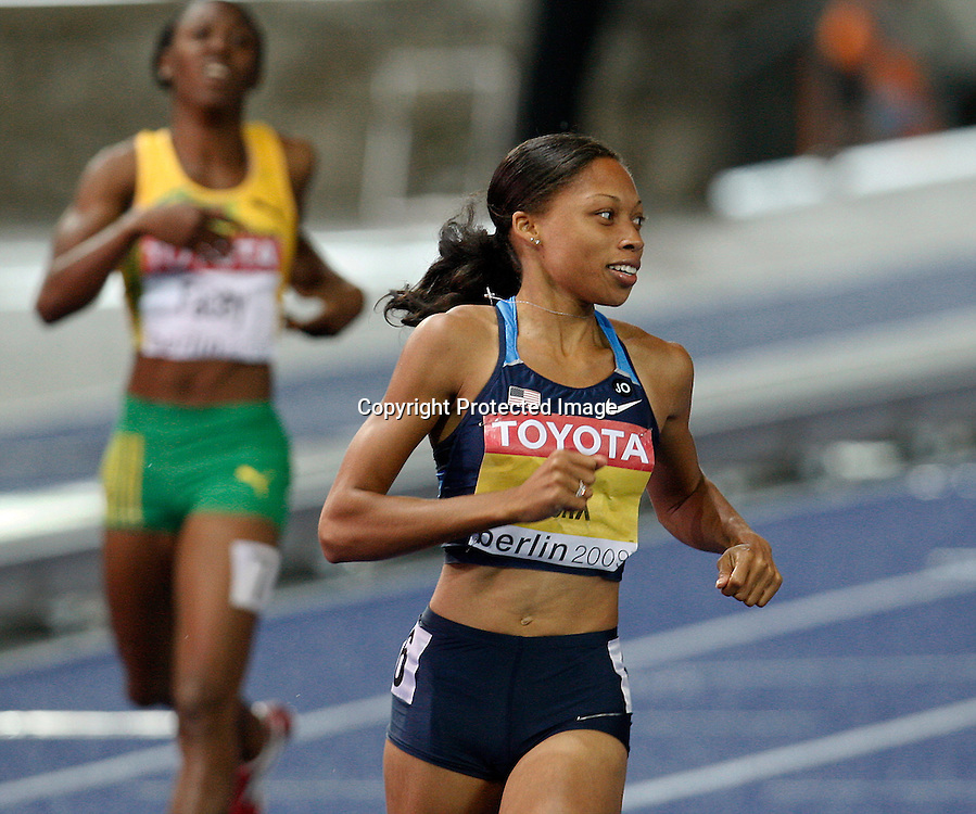 BERLIN 21/08/2009<br />12th IAAF World Championships in Athletics Berlin 2009<br />Allyson Felix of the United States celebrates after winning the gold medal in the final of the Women's 200m during the World Athletics Championships<br />Photo: Piotr Hawalej / WROFOTO / PHOTOSPORT