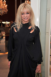 JO WOOD at a party to launch the Georgina Chapman collection for Garrard held at Garrard, Albermarle Street, London on 4th November 2009.