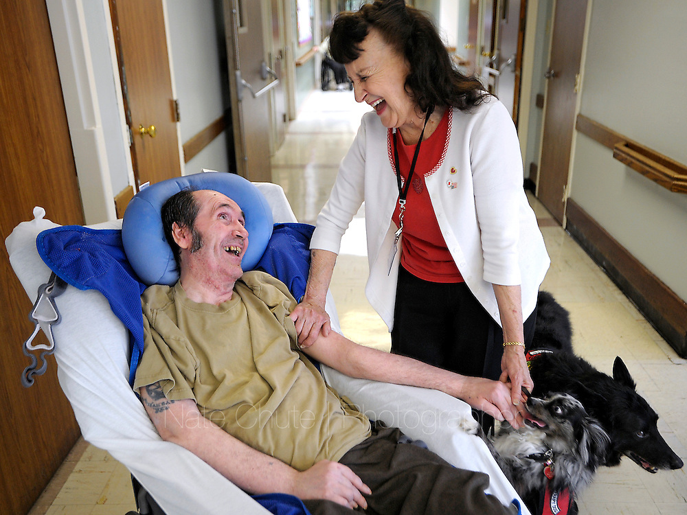 Kathleen Morris brightens peoples' days with her therapy dogs at Yuba Skilled Nursing Center in Yuba City on Thursday, April 12, 2012. (Nate Chute/Appeal-Democrat)