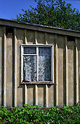 Abandonned prefab in Chesterfield, 2005. Thousands of post-war prefabs are still being lived in and cherished by their tenants or owners all over the UK.