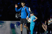 Novak Djokovic comes to the court during the final of the ATP World Tour Finals between Roger Federer of Switzerland and Novak Djokovic at the O2 Arena, London, United Kingdom on 22 November 2015. Photo by Phil Duncan.