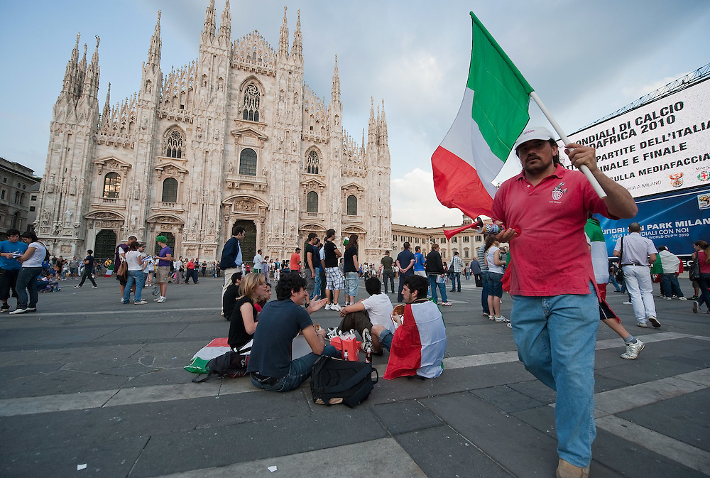 MILAN, ITALY - JUNE 14:  Italian fans gather in front of the maxi screen to watch Italy vs Paraguay match in Piazza del Duomo on June 14, 2010 in Milan, Italy. Italy's national football team managed a draw 1-1 against Paraguay in their first match of FIFA 2010Soccer World Cup.