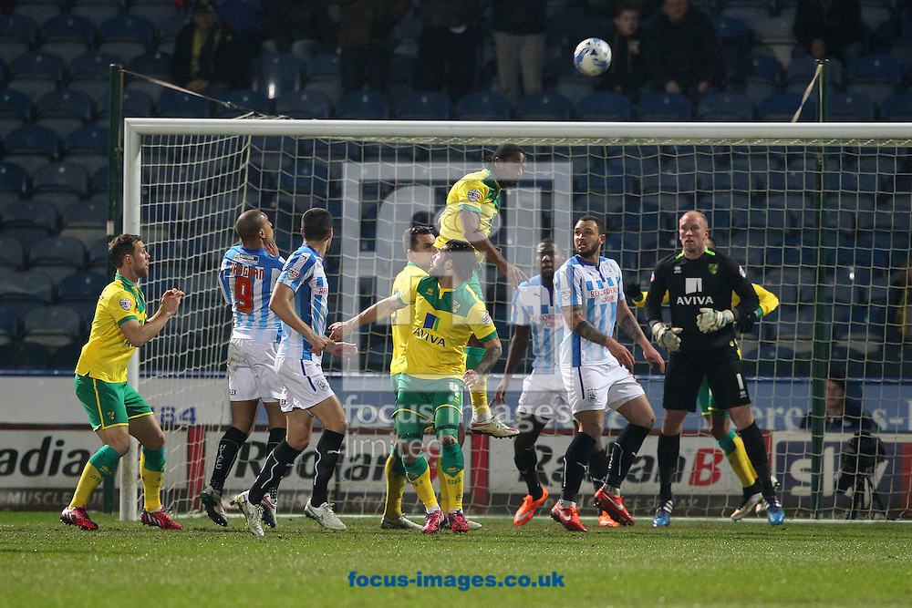 Cameron Jerome of Norwich heads clear during the Sky Bet Championship match at the John Smiths Stadium, Huddersfield<br /> Picture by Paul Chesterton/Focus Images Ltd +44 7904 640267<br /> 17/03/2015